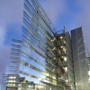 View of the exterior of the Owen G architecture, building, city, commercial building, condominium, corporate headquarters, daytime, facade, headquarters, metropolis, metropolitan area, mixed use, reflection, residential area, sky, skyscraper, tower block, urban area, blue