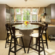 View of kitchen, glass; granite and stone countertops, chair, countertop, dining room, flooring, furniture, interior design, kitchen, room, table, yellow, brown, orange