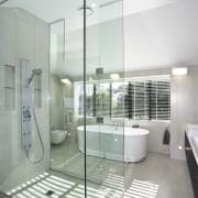 The glass shower enclosure separates the dressing room architecture, bathroom, condominium, daylighting, floor, glass, interior design, real estate, gray, white