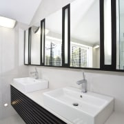 The vanity was custom designed and features twin architecture, bathroom, interior design, product design, sink, tap, white