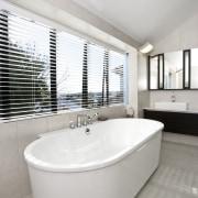 View of the Hoesch Foster bathtub. architecture, bathroom, bathtub, floor, interior design, plumbing fixture, property, real estate, room, tap, window, gray, white