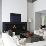 View of the lounge which features pure white furniture, hearth, home, interior design, living room, room, table, white