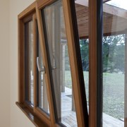 View of windows set into timber joinery by daylighting, door, sash window, window, wood, wood stain, gray