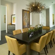 View of dining table with yellow chairs. dining room, furniture, interior design, living room, property, real estate, room, table, brown