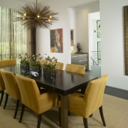 View of dining table with yellow chairs. chair, dining room, furniture, interior design, living room, real estate, room, table, brown