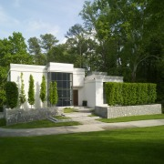 View of white home. architecture, estate, facade, garden, grass, home, house, landscape, lawn, mansion, property, real estate, yard, green