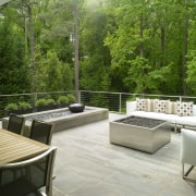 View of balcony with trees. backyard, furniture, interior design, outdoor structure, patio, real estate, table, green