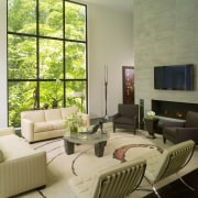 View of lounge with white couches. furniture, interior design, living room, real estate, room, table, window