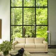 View of white couch. green, home, house, interior design, living room, window, window covering, window treatment, wood, brown, yellow