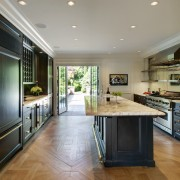 A light-filled space was the result when architect cabinetry, countertop, cuisine classique, estate, floor, flooring, interior design, kitchen, real estate, room, gray