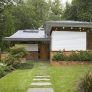 This house was transformed in a two-stage remodel backyard, cottage, courtyard, estate, facade, garden, grass, home, house, landscape, landscaping, lawn, plant, property, real estate, residential area, roof, siding, yard, brown, green