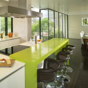 This house was transformed in a two-stage remodel architecture, countertop, interior design, kitchen, real estate, yellow