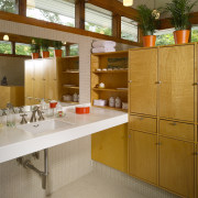 This house was transformed in a two-stage remodel architecture, cabinetry, countertop, interior design, kitchen, brown