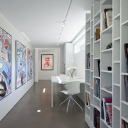 White walls and shelving show off the owners bookcase, ceiling, exhibition, floor, furniture, interior design, shelf, shelving, wall, gray