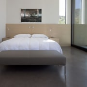 For visual continuity, similar materials appear in the architecture, bed, bed frame, bedroom, floor, flooring, furniture, interior design, mattress, property, real estate, room, wood flooring, gray, black