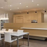 The kitchen in this desert house incorporates a ceiling, conference hall, dining room, floor, flooring, furniture, interior design, real estate, room, table, brown, gray