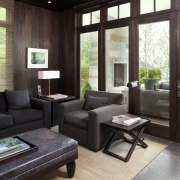 This study room in a traditional lakefront house furniture, interior design, living room, real estate, window, black, white
