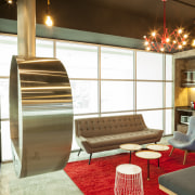 Exposed concrete is off-set by pops of colour furniture, interior design, room, table, brown