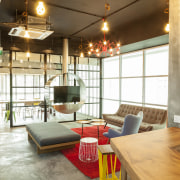 Breakout space and kitchen in concrete and glass. ceiling, interior design, living room, loft, real estate, brown, white