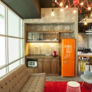 Warner Music - Vibrant hip workplace interior design, loft, brown, white