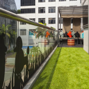 Vibrant artificial grass features on balcony of fit-out architecture, grass, plant, black