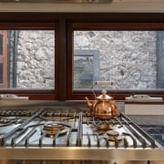 This kitchen window opens onto the back wall countertop, daylighting, interior design, window, gray, brown