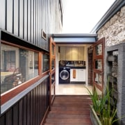 A small, flat-roofed linking element fits between the home, house, interior design, property, real estate, black