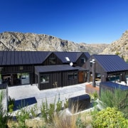 Strategic changes have updated this 20-year-old mountain home alps, cottage, elevation, estate, home, house, hut, mountain, mountain range, mountain village, mountainous landforms, property, real estate, roof, sky, villa, blue