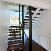 As part of a renovation to open a architecture, daylighting, floor, flooring, handrail, hardwood, home, house, interior design, real estate, stairs, wood, gray