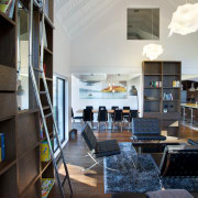A storage wall and library-style access ladder were interior design, lobby, gray, black