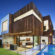 Several different materials feature on the exterior of architecture, building, elevation, estate, facade, home, house, property, real estate, residential area, siding, wood, blue
