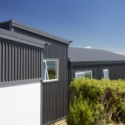 This new Christchurch house is a composition of architecture, building, cottage, facade, home, house, property, real estate, roof, shed, siding, window
