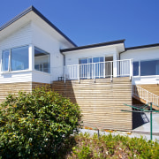 This new Christchurch house features Palliside low-maintenance weatherboards cottage, elevation, estate, facade, home, house, property, real estate, residential area, siding, sky, villa, window, blue