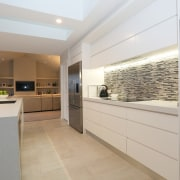This kitchen in a new home by SS countertop, interior design, kitchen, property, real estate, gray