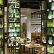 Two tall wine towers serve as dividers in distilled beverage, liquor store, brown