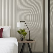 Guest rooms at the new DoubleTree by Hilton bed frame, bedroom, curtain, floor, home, interior design, room, shade, textile, wall, wallpaper, window, window blind, window covering, window treatment, wood, gray