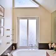 As another link to this home's past, the bathroom, ceiling, daylighting, home, interior design, room, sink, window, white, gray