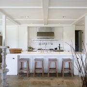 This entertainer's kitchen has an engineered stone benchtop ceiling, countertop, cuisine classique, dining room, estate, floor, flooring, interior design, kitchen, real estate, room, table, gray