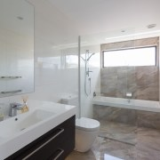 This main upstairs bathroom has a large-format porcelain architecture, bathroom, home, interior design, property, real estate, room, sink, gray