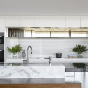 Mirrored over-bench cabinets reflect the feature timber ceilings architecture, countertop, furniture, home, house, interior design, kitchen, product design, table, tap, gray, white