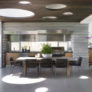 This indoor-outdoor kitchen opens to a front terrace ceiling, interior design, lobby, gray, white