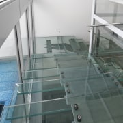 Glass circulation stairs overlook a glistening lane pool architecture, daylighting, floor, glass, handrail, line, structure, gray, white