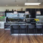 This kitchen's black, reflective cabinetry runs on into floor, flooring, interior design, kitchen, real estate, gray, black