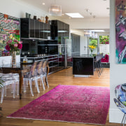 This kitchen by designer Damian Hannah provides a floor, home, interior design, living room, real estate, room, wall, gray
