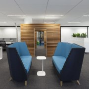 Office utility spaces are contained in timber-slatted pods furniture, interior design, office, product design, gray, black