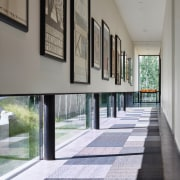 This passageway in the guest wing of a architecture, floor, flooring, house, interior design, real estate, window, gray