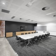 A meeting space in the Core Library has architecture, ceiling, conference hall, daylighting, floor, flooring, interior design, office, table, gray