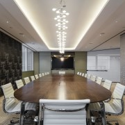 This boardroom at the VMS headquarters has the ceiling, conference hall, interior design, real estate, table, gray