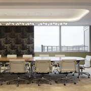 A cove ceiling and operable wall panels finished ceiling, conference hall, flooring, interior design, table, wall, gray