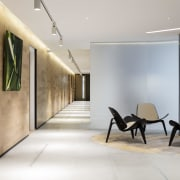 A timber feature wall, sandstone floors, a stainless architecture, ceiling, floor, flooring, interior design, lobby, white